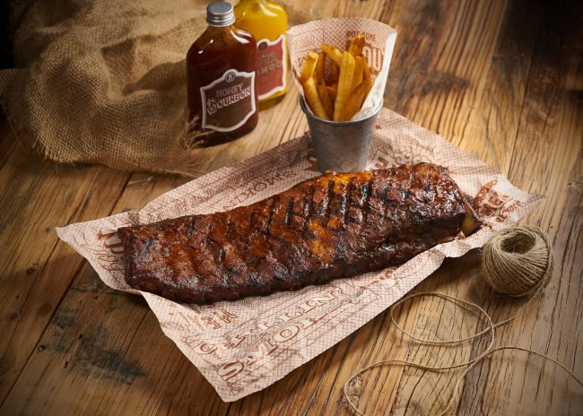 Hospitality photography for Bourbon Cookhouse rack of ribs poster shot on-location, in Shanghai. Shanghai photographer with studio creates still-life imagery for advertising and marketing materials.