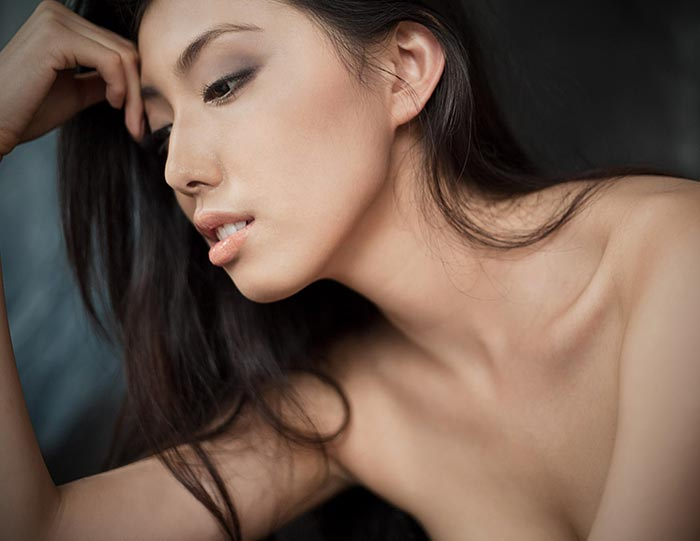 Chinese female model portrait shot in studio, in Shanghai. Shanghai photographer with studio creates natural beauty portrait imagery for advertising and marketing materials.